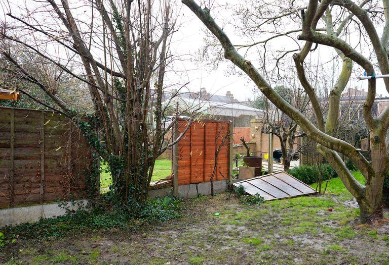 Garden fence knocked down during storm Ciara, Kent, UK