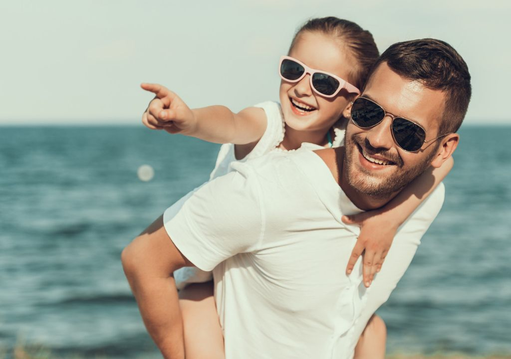 Father and daughter in sunglasses