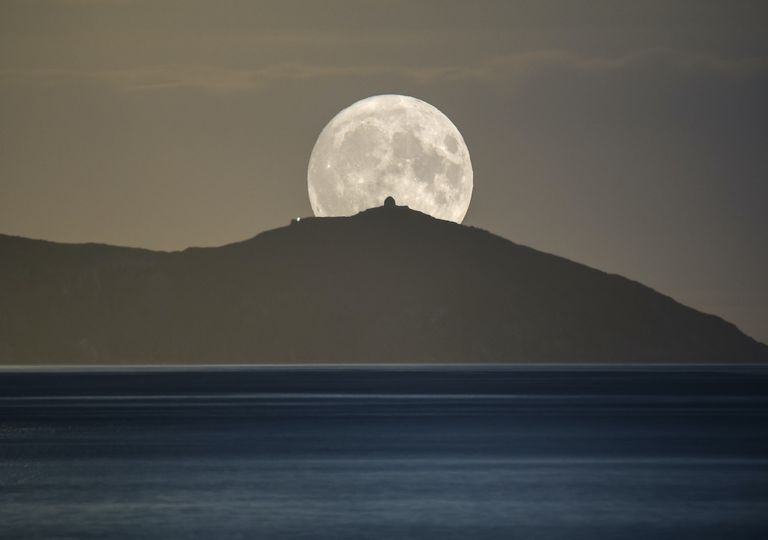 Harvest Moon rising image from Cornwall, UK.