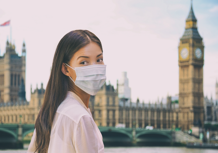 Young person in London wearing face mask.