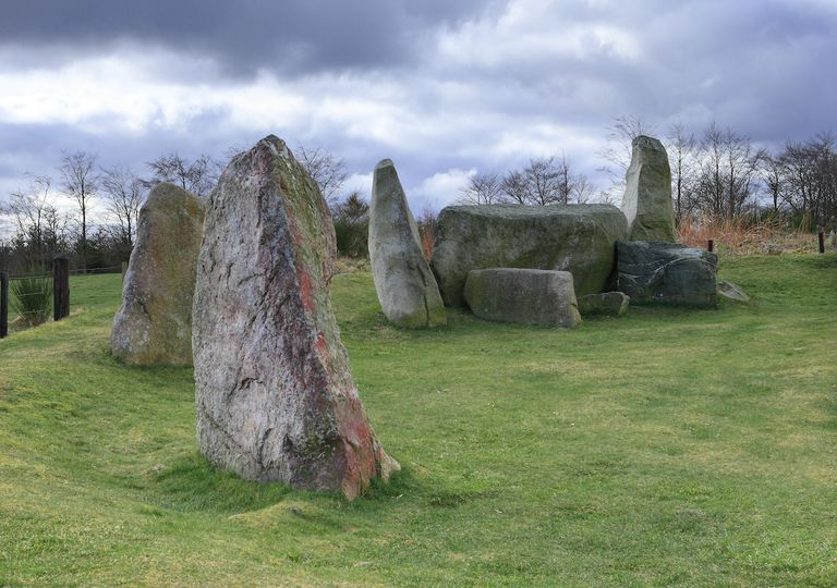 Inverurie stone circle with grey rainclouds.