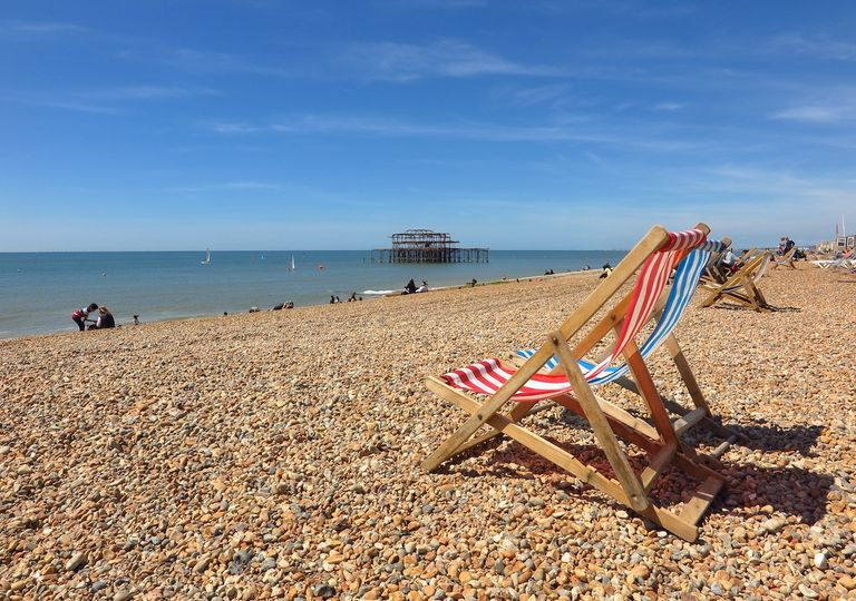 Deckchairs on beach.