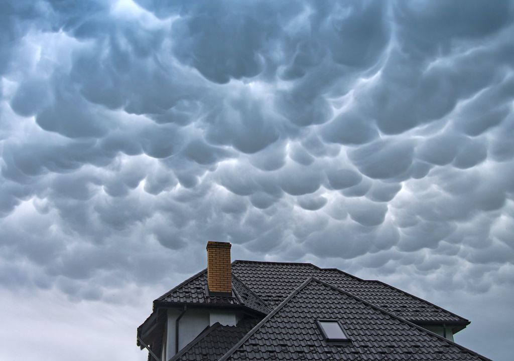 Mammatus clouds over house.