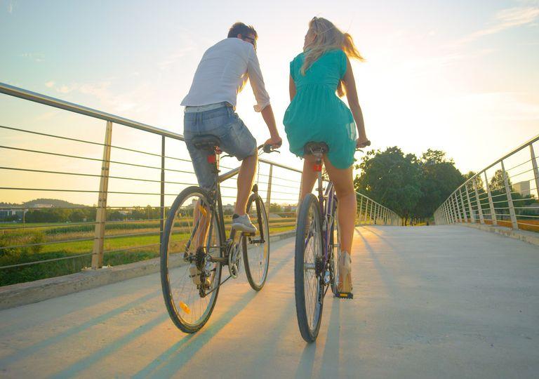 Couple ride bikes in the sun